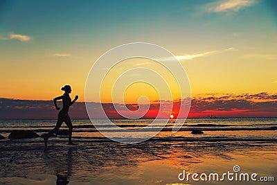 Female runing along the sea coast