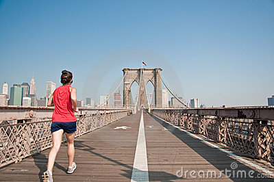 Female runner going though Brooklyn Bridge Editorial Image