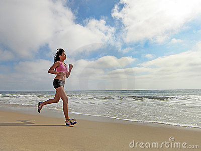 Female Runner Running at the Beach Jogging