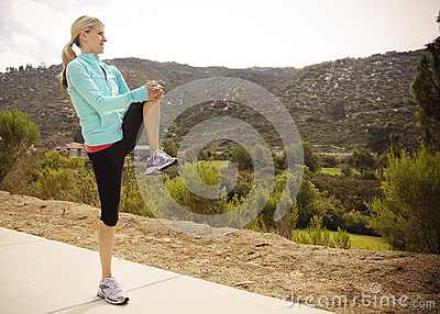 Female Runner Stretching before Workout