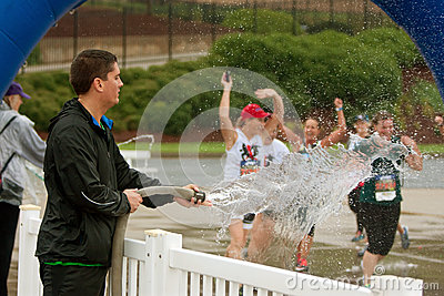 Female Runners Get Soaked By Fire Hose At Finish Line Editorial Stock Image