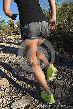 Free Female Running Up Desert Mountain Stock Images - 47901524