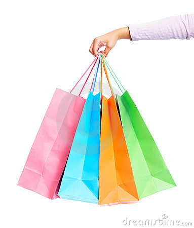 Female s hand holding colorful shopping bags