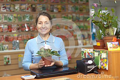 Female saleswoman  at store for gardener