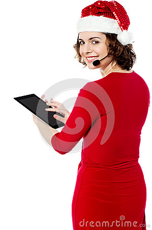 Female santa browsing on her tablet pc