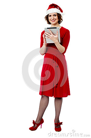Female in santa cap using tablet pc