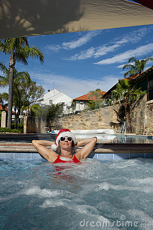 Female Santa Claus relaxing in Spa