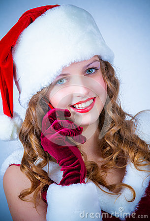 Female Santa enjoying a snowy Christmas and cellular
