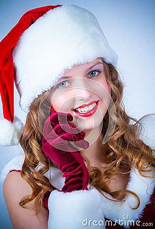 Female Santa enjoying a snowy Christmas and cellular