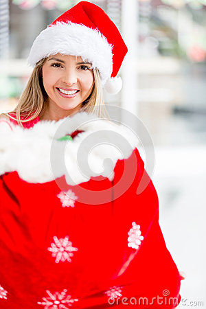Female Santa with a gift sack