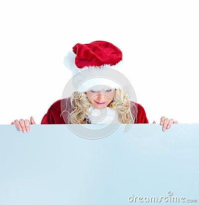 Female santa looking down at copyspace