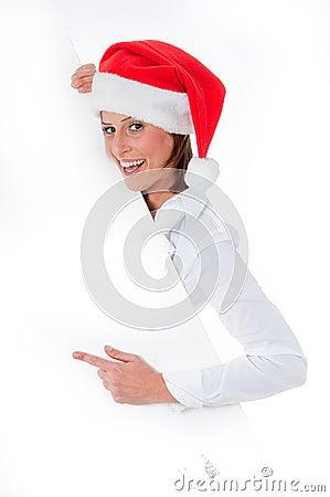 Female Santa pointing down at blank billboard