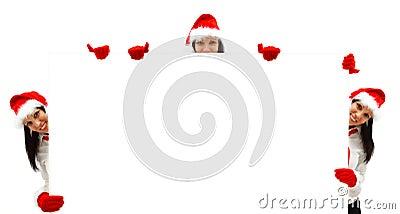 Female Santas over a billboard