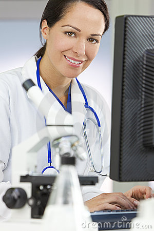Female Scientist Doctor and Computer In Laboratory