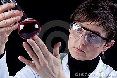 Female Scientist experimenting