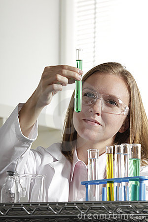 Female scientist in the lab with test tube, vertic