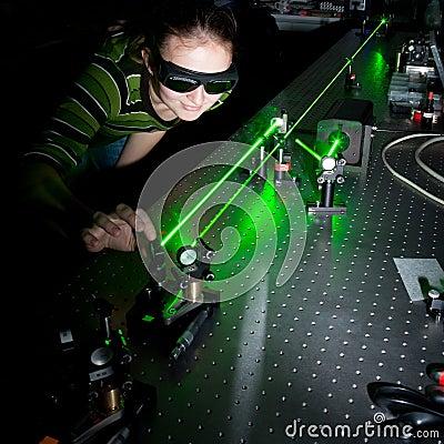 Female scientist  in a quantum optics lab