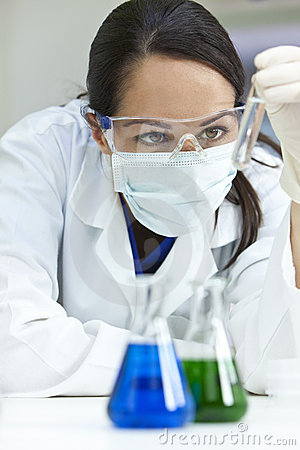 Female Scientist with Test Tube In Laboratory