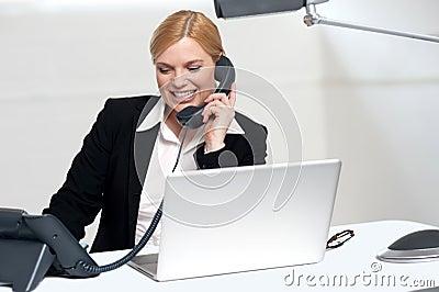 Female secretary communicating with her boss