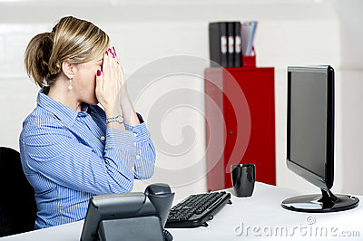 Female secretary hiding her face with hands