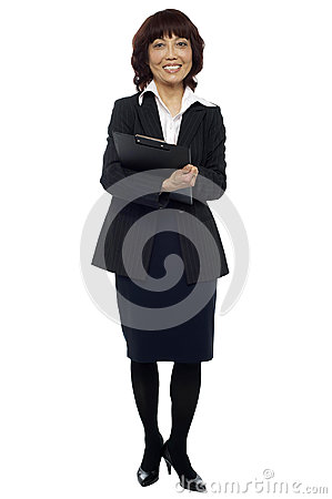 Female secretary holding clipboard