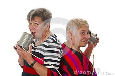 Female senior talking with can telephone
