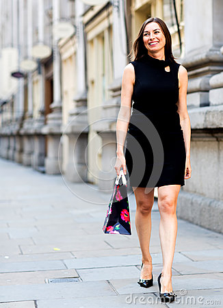 Female shopper walking outdoors