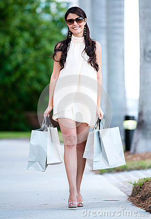 Female shopper walking on the street