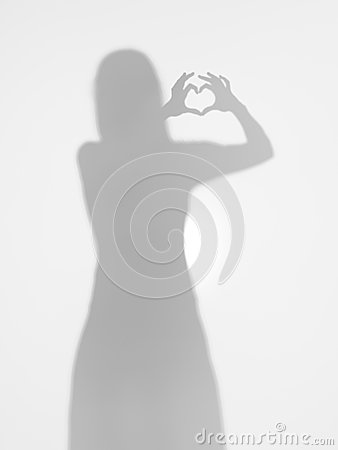 Female silhouette making a heart shape with her hands