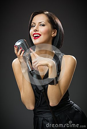 Free Female Singer Keeping Microphone Royalty Free Stock Photography - 35294407
