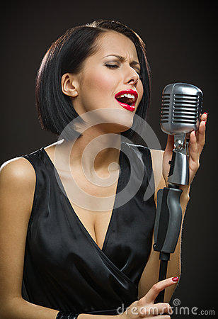 Free Female Singer With Closed Eyes Keeping Microphone Stock Photo - 35294430