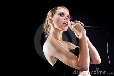 Female singing into microphone