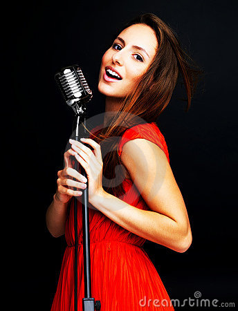 Female singing with old fashioned microphone