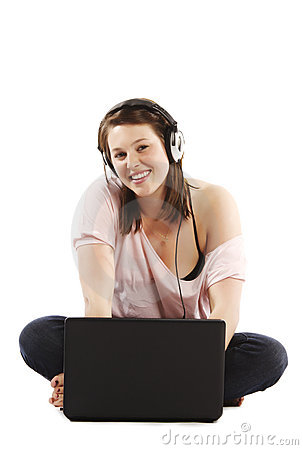 Female sitting on the floor with headphones on