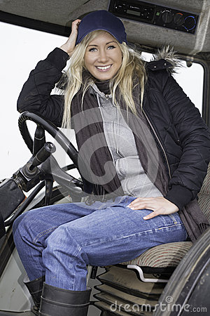 Female sitting in a tractor