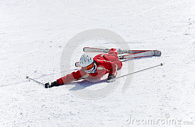 Female skier after falling down