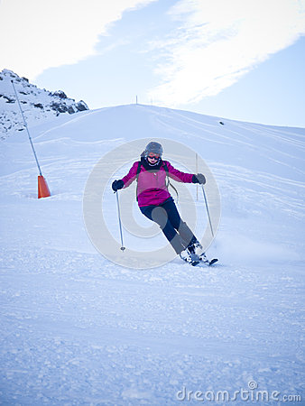 Female skier with helmet