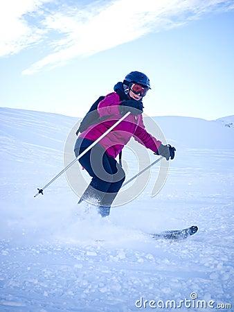 Female skier with helmet