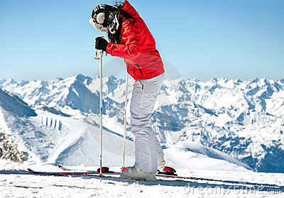 Female skier on ski slope in european alps
