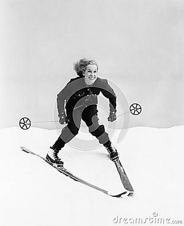 Free Female Skier Skiing Downhill Royalty Free Stock Photos - 52018748