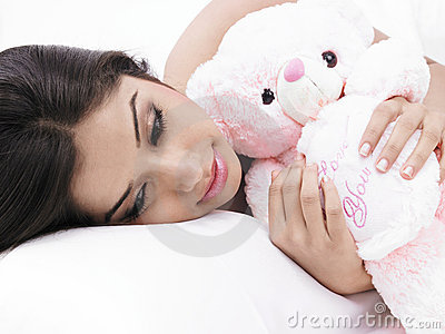 Female sleeping with her teddy