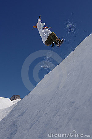 Female snowboarder half pipe