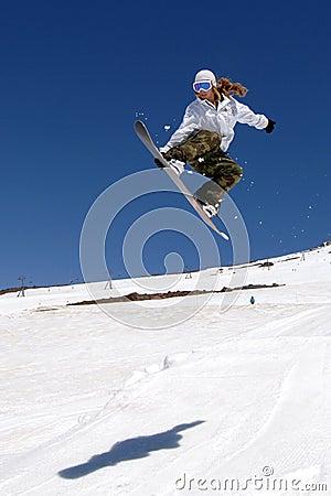 Female snowboarder jump shadow