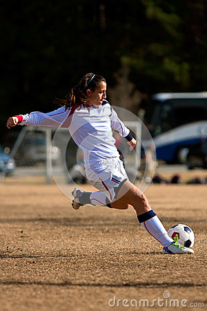 Female Soccer Player Prepares To Kick Ball