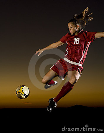 Female Soccer Player About to Kick the Ball
