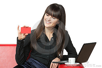 Female on sofa going to make online purchases