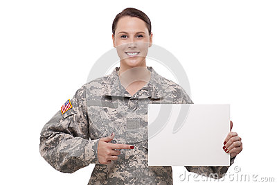 Female soldier pointing at a blank placard