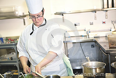 Female sous chef cooking