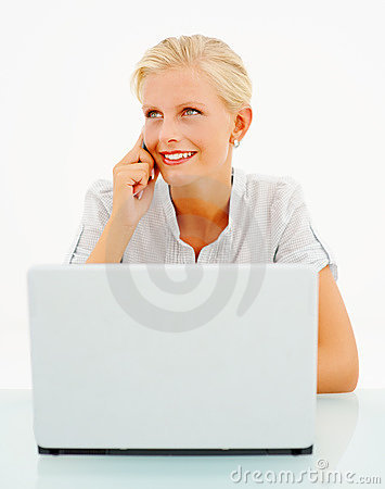 Female speaking on  mobile and using a laptop