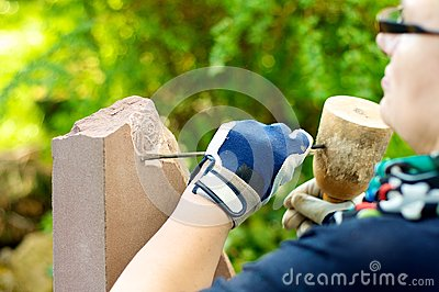 Female stonemason at work